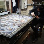 Johan, the framer, busy with a very large puzzle.